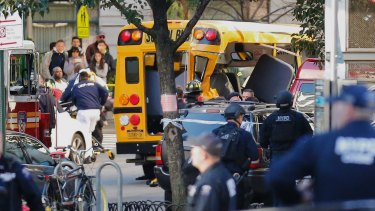 Some people were being treated for injuries near a mangled school bus.
