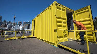 The final touches are made to Containers, a new exhibition housed entirely in six 20-foot shipping containers at the Australian National Maritime Museum.