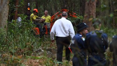 An excavator helps in the search for Matthew Leveson's body in the Royal National Park on Friday.