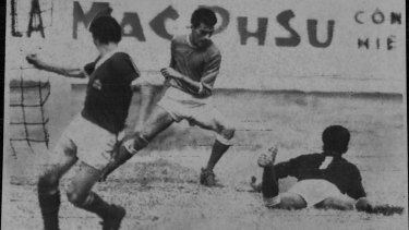 Singapore's goalkeeper (No. 1) goes down at the feet of Australian player Ray Baartz.