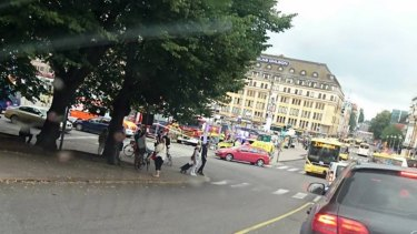 Emergency services at Market Square in Turku, where several people were stabbed and a man was shot by police.