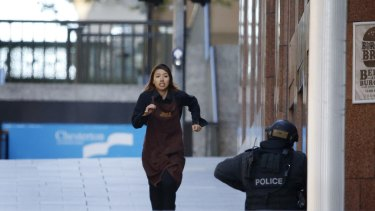 A Lindt worker believed to be Elly Chen flees the cafe.