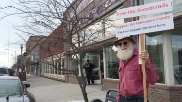 Kim Rollins, 64, outside the Harney County Community Centre in Burns, Oregon, appeals for the release of a father and son jailed in California for arson prompted the refuge occupation.