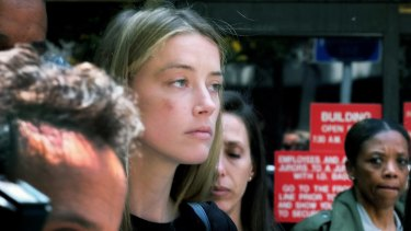 Actress Amber Heard leaves Los Angeles Superior Court in May, after giving a sworn declaration that her husband Johnny Depp threw her mobile phone at her during a fight, striking her cheek and eye.