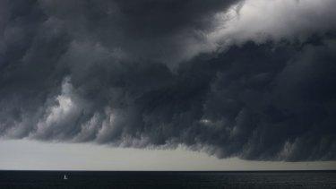 A yacht is dwarfed by last week's big storm cell off Sydney.