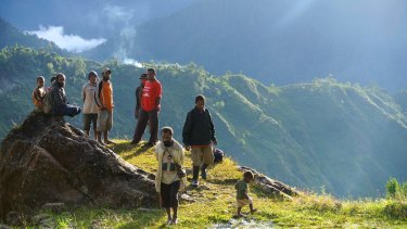 Men gather to talk in the remote highlands village of Lolat.