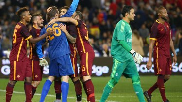 Grinners: AS Roma Players celebrate after winning the penalty shootout to decide the match.