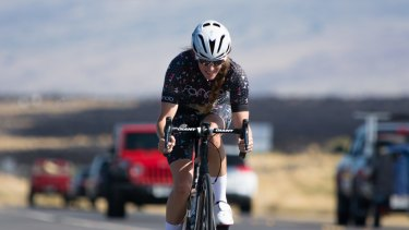 A woman on the road in Fondo cycling gear.