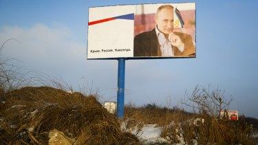 A billboard with a portrait of Russian President Vladimir Putin on the road outside Simferopol, Crimea.