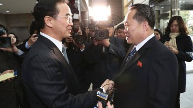 South Korean Unification Minister Cho Myoung-gyon, left, shakes hands with the head of North Korean delegation Ri Son-gwon before their meeting on Tuesday.