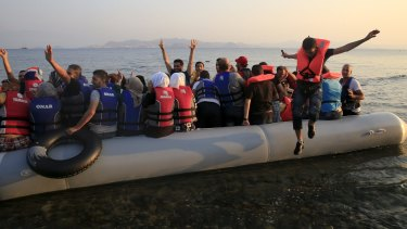 Syrian refugees rush to shore on Kos.