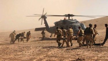 Australian and Afghan troops  evacuate civilian victims of a Taliban roadside bomb in Uruzgan Province, Afghanistan.