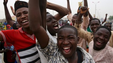 Supporters of Muhammadu Buhari and his All Progressive Congress celebrate the election win in Kano.