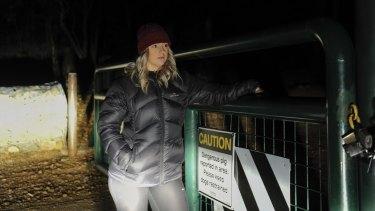 Michaela Vodvarka at Mount Jerrabomberra on Monday night near a sign warning of a dangerous pig.