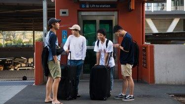 Kodai Yasui, Shuia Kamo, Taichi Matsui and Ugyen Tashi would rather order an Uber outside Wolli Creek Station than catch the train to Sydney Airport.