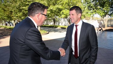 Victorian Premier Daniel Andrews greets NSW Premier Mike Baird ahead of COAG in Canberra on Friday.