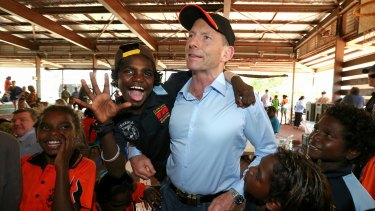 Prime Minister Tony Abbott with excited school children at Yirrkala School during his visit to North East Arnhem Land in September last year.