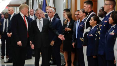 President Donald Trump and Vice-President Mike Pence with Defence Secretary Jim Mattis, centre, greet military personnel during their visit to the Pentagon last month.