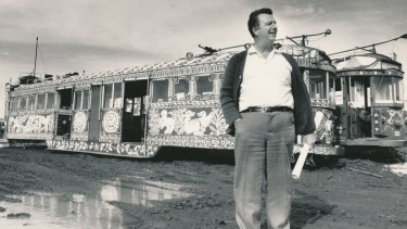 Jim Johnson, a Melbourne scrap metal dealer who planned to create a tram theme park, bought 14 art trams, including Mirka Mora's, pictured behind him. He sold the trams in the late 1980s.