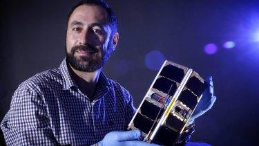 UNSW QB50 project leader Elias Aboutanios holding the Ec0 CubeSat.