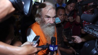Accused Australian paedophile Robert Andrew Fiddes Ellis talks to reporters in a courtroom in Bali on Tuesday.