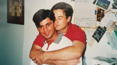 Jones (in red shirt) lost his boyfriend Stephen to AIDS-related illness.