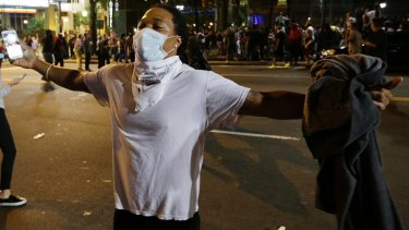 Protesters rushed police in riot gear at a downtown Charlotte hotel and officers have fired tear gas to disperse the crowd.