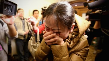 Anguish in Beijing as relatives learn MH370 has gone missing on March 9, 2014.