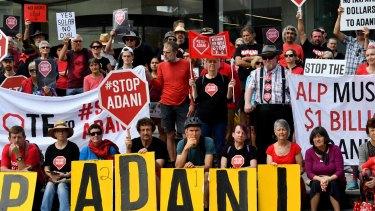 Protestors against the Adani coal mine rally outside Adani's headquarters in Brisbane.