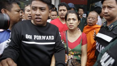 Bou Rachana arrives at the scene where her husband was shot dead in Phnom Penh.