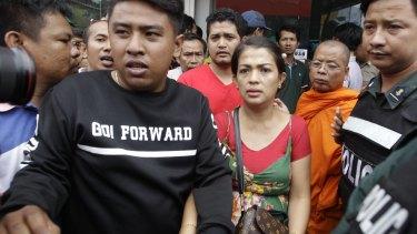 Bou Rachana arrives at the scene where her husband was shot dead in Phnom Penh.