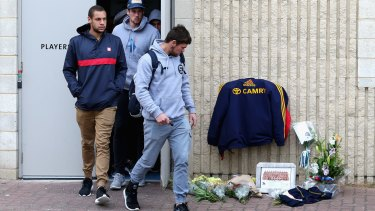 Players leave the clubrooms at Adelaide Crows headquarters.