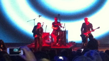 U2 perform on stage before releasing their new album for free on iTunes.