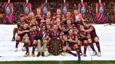 The victorious Queenslanders celebrate after State of Origin.