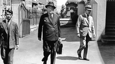 Robert Menzies arriving at a federal cabinet meeting held at Parliament House in Sydney,  1941.