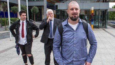 Right-wing activist Neil Erikson (right) outside court on Monday.