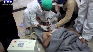 A victim of a suspected chemical attack receives treatment at a makeshift hospital.