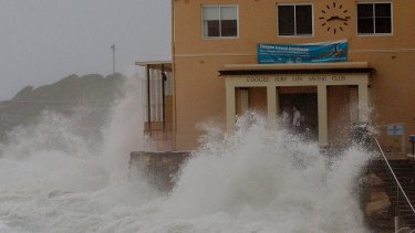 Damage done: The clubhouse was lashed by giant waves during the storms earlier this month.