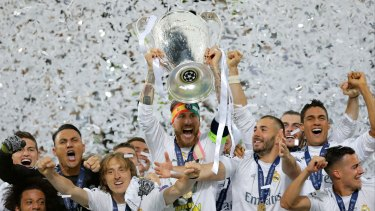 Trophy time: Real Madrid's Sergio Ramos celebrates after the Champions League final win over Atletico Madrid at the San Siro stadium in Milan, Italy.