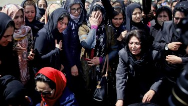 Women mourn during the funeral of 27-year-old Farkhunda.