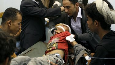 A boy injured in crossfire during fighting between fighters of the Popular Resistance Committees and Houthi fighters is rushed to hospital in Yemen's south-western city of Taiz on Monday.