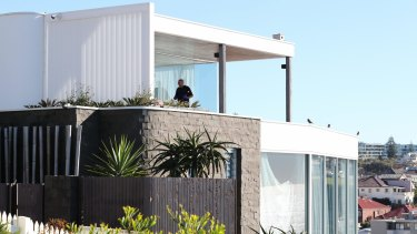 Police search John Ibrahim's Dover Heights home in Sydney.