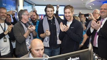Atlassian co-founders Mike Cannon-Brookes and Scott Farquhar watch as their company's shares open on the Nasdaq.