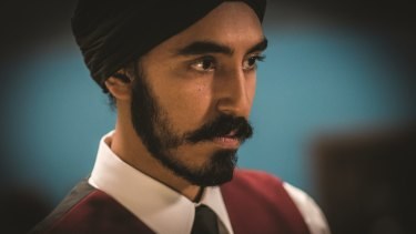 Dev Patel as Arjun, a poor waiter, in Hotel Mumbai.