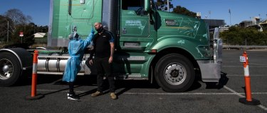 Truck driver Mick Cummings having a COVID test at the Leumeah Drive through COVID-19 testing clinic. He works at a truck depot in Campbelltown and lives in the Southern Highlands, he is required to have a COVID test every three days, his work takes him interstate. Campbelltown LGA during Lockdown. COVID-19 Coronavirus. 30th July 2021 Photo Louise Kennerley . contact 0404589318 SMH