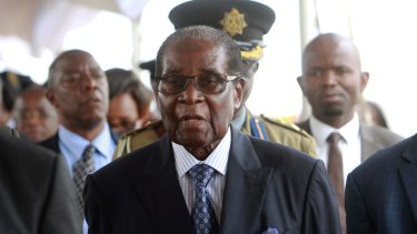 Zimbabwean President Robert Mugabe arrives to make his first public appearance, at a graduation ceremony on Friday, since the military put him under house arrest last week.