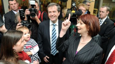 On the up: With then PM Julia Gillard in 2010.