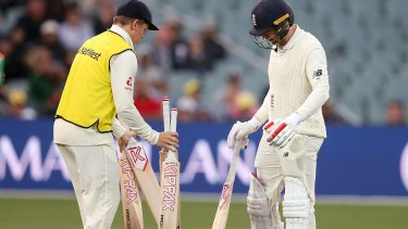 England's Mark Stoneman, right, selects a new bat after damaging his during the second day of their Ashes test match.