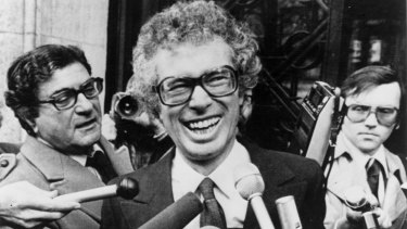 Then Canadian ambassador to Iran Ken Taylor laughs as he answers journalists questions journalists outside the Canadian embassy in Paris in 1980.