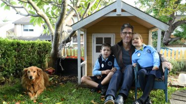 Chris Jolly and his children Oscar, 8, and Eloise, 6, at their Rozelle home.